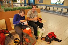 Em and Chris have a quick snack (Trondheim airport, Norway) resize