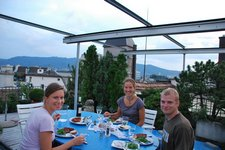 Marie, Jane, and Cris eating dinner on the roof (Zuerich) resize