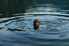 Emily swims in the Freiburgsee (Allgaeu, Germany) resize