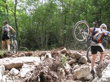Carrying bikes through the rubble of a new road (Lago di Garda) resize