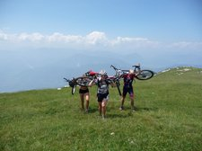 Frauke, Emily, and Cris carrying there bikes to the top of Monte Stivo (Lago di Garda, Italy) resize