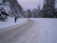 Skiing down the access road (Ski Touring, Schwarzwald, Germany) resize