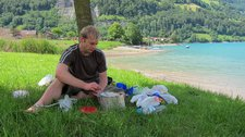 Cris cooking by the lake (Lungern, Switzerland) resize