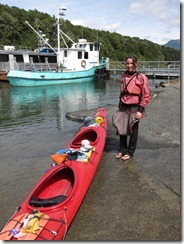 Leonie with kayak about to launch (Seakayaking Manapouri)