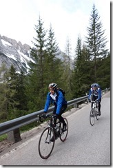 Thomas and Marco smiling on the way up the first pass (Cycling Dolomites)