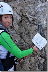 Leonie spots her klettersteig set on the warning sign (Karhorn Klettersteig)