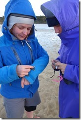 Katie and Gina with a crab (Cycle touring Catlins Jan 2014)