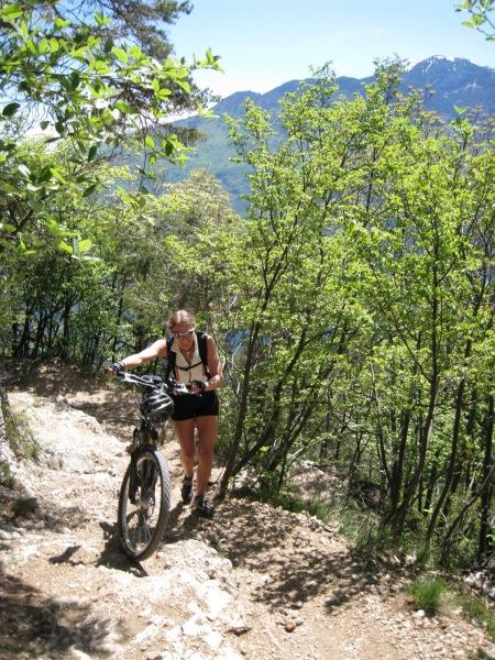 Frauke pushing her bike (Lago di Garda, Italy)