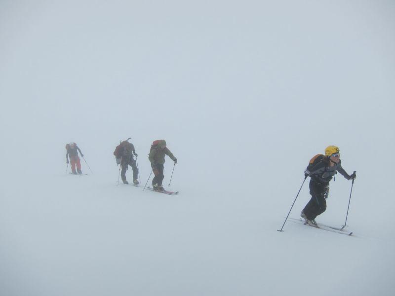 Trekking through the mist (Langdalstindane, Norway)