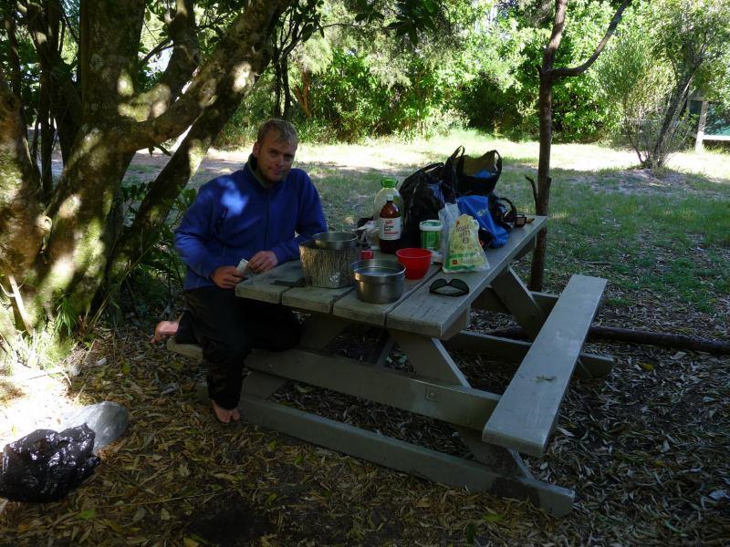 Cris at picnic table at Sandfly Bay (Abel Tasman)