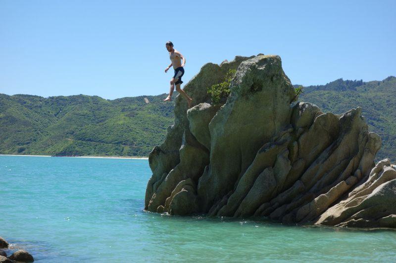 Brendan jumps off the rock (Takaka 2013)