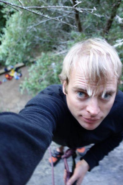 Cris at the top of his climb (Takaka 2013)