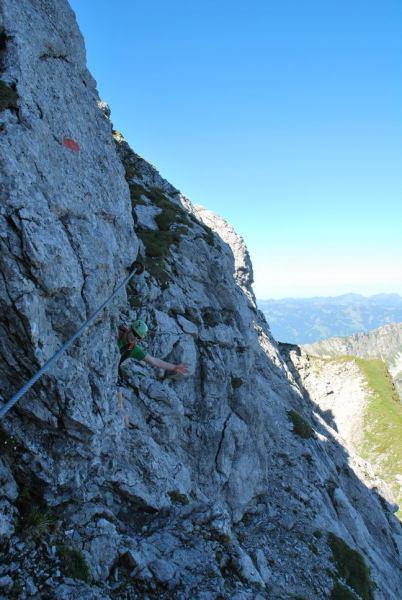 Cris behind a rock (Nebelhorn Klettersteig, Germany)