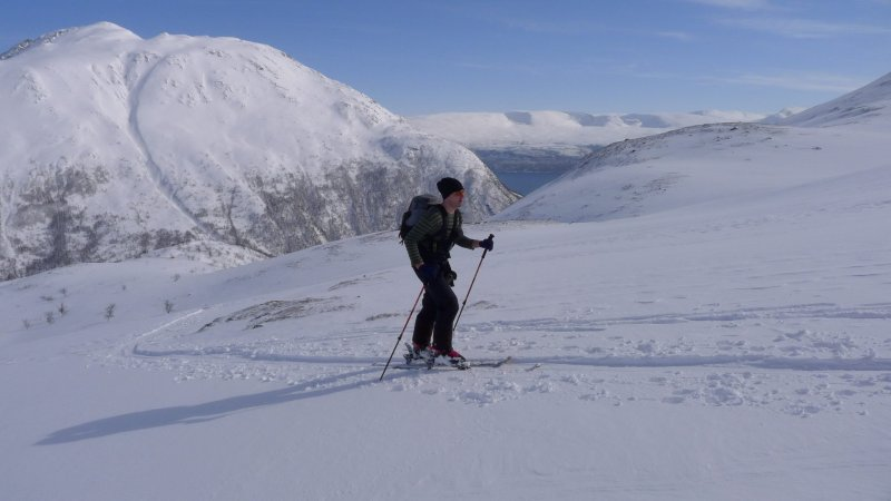 Cris ascending with fiord in background (Daltinden, Norway)