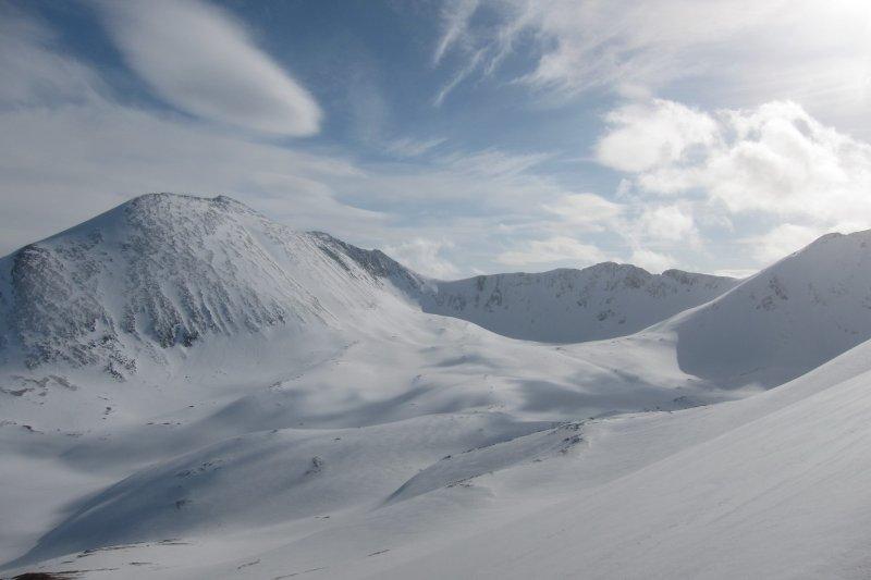 Snowy moutains (Rørnestinden, Norway)