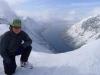 Cris on summit with fiord behind 2 (Rørnestinden, Norway)