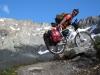 Cris pushes his bike up to Sertigpass (Switzerland)