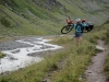 Emily carrying her bike down the rive (Switzerland)