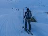 Heading off with snow stake (Ski touring Jamtalhuette)