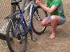 Cris attempts to fix Leonie's gears (Mallorca)
