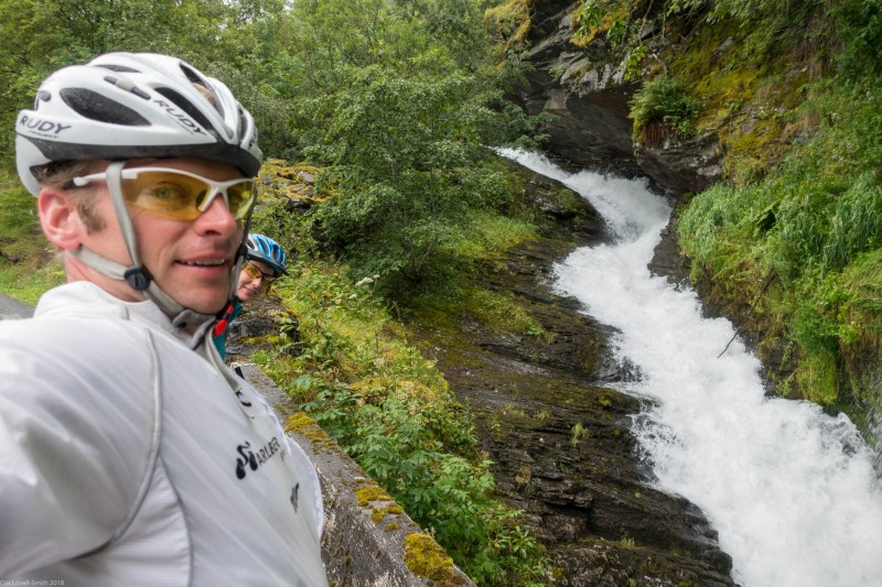 Cris, Leonie, and waterfall (Cycle Touring Norway 2016)