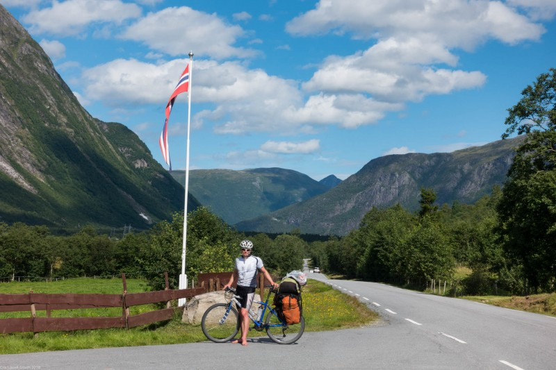 Cris and Norwegian flag (Cycle Touring Norway 2016)