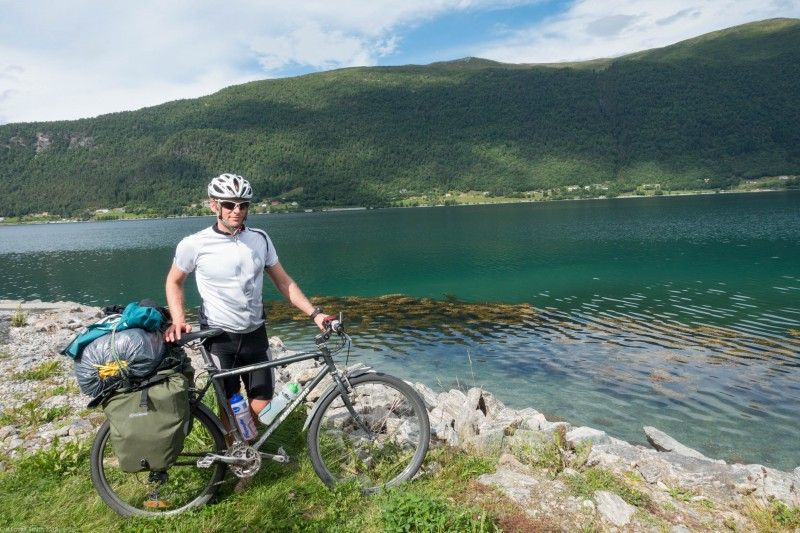 Cris at the sea again (Cycle Touring Norway 2016)