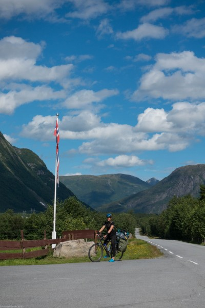 Leonie by the flag (Cycle Touring Norway 2016)