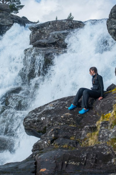 Leonie sitting by the waterfall (Cycle Touring Norway 2016)