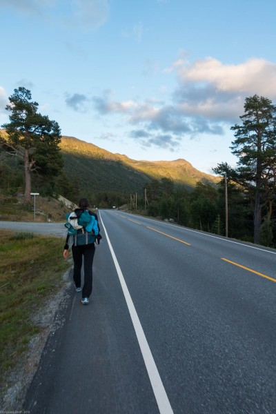 Leonie walking along the road (Cycle Touring Norway 2016)