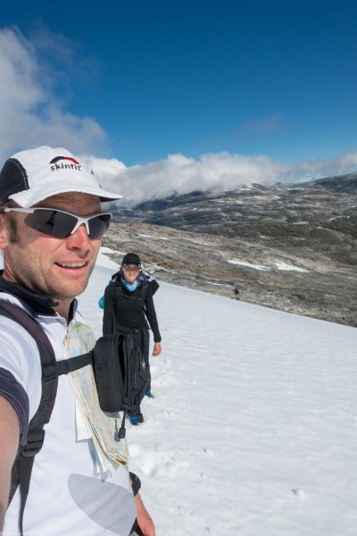 Us crossing a snow field (Cycle Touring Norway 2016)