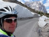 Cris with snow by the road (Cycling  Dolomites)