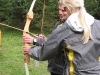 Emily explains how to use a bow and arrow to Cris (Faszi Adventure, Haiming, Austria)