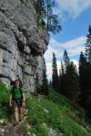 Cris walking under cliffs (Slovenia)