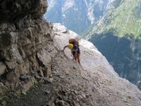 Em climbing near cliff (Triglav Nat. Park, Slovenia)