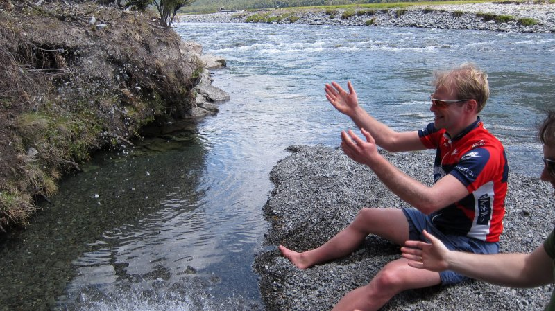 Throwing rocks into the river (30th Birthday Bash)