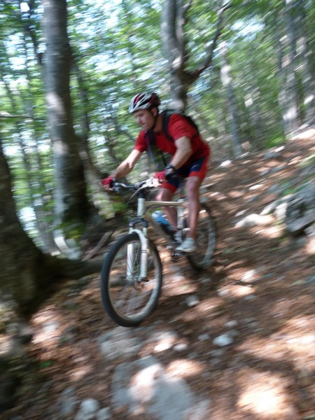 Chris descending through forest (Lago di Garda, Italy)