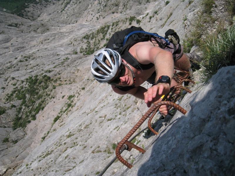 Cris reaches for ladder (Lago di Garda, Italy)