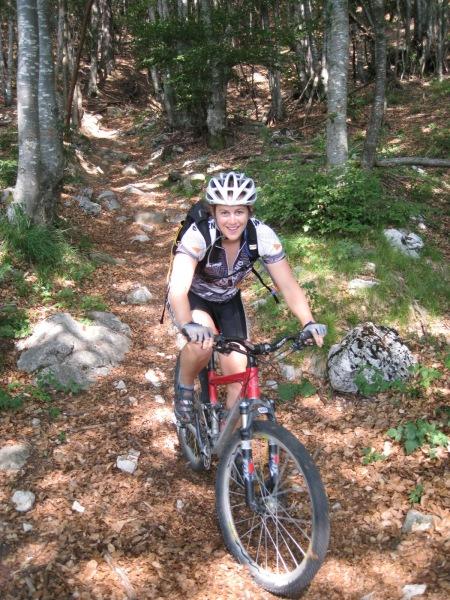 Emily descending through forest (Lago di Garda, Italy)