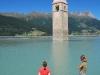 Emily and Frauke watch the church swim (Reschenpass, Italy)