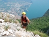 Emily on klettersteig with Riva below (Lago di Garda)