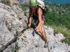 Frauke on klettersteig with Riva below (Lago di Garda)
