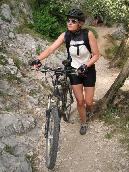 Frauke pushing bike (Lago di Garda)