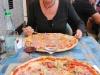 Eating pizza (Lago di Garda, Italy)