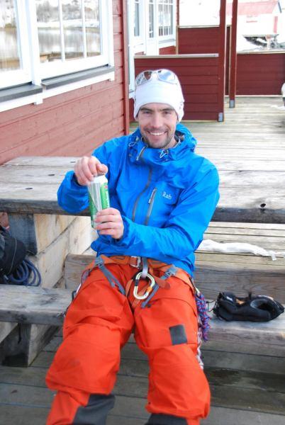 Aly opens a beer (Lyngen Alps, Norway)