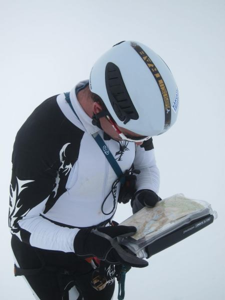 Chris reading the map in white out (Langdalstindane, Norway)
