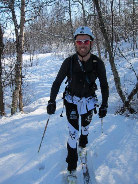 Chris skinning through the trees (Daltinden, Norway)