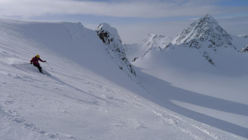 Emily skiing off the summit (Tafeltinden, Norway)