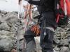 Tim carrying skis through stream (Tomesrenna, Norway)
