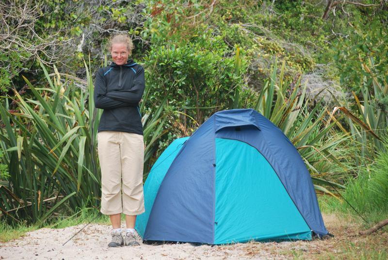 Frauke beside our tent (Tonga Quarry, Abel Tasman)